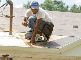 roofer repairing roof