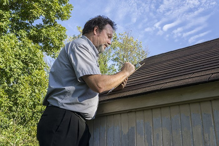 HOW DO I KNOW WHEN IT'S TIME TO HAVE MY ROOF REPLACED AND NOT JUST REPAIRED?