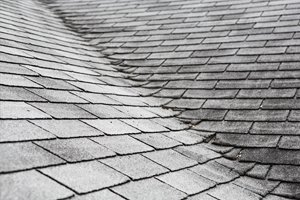 Old roof with worn out shingles   How to Tell It's Time for a New Roof